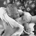 Birth Photography newborn baby girl is being received by her mother at Fort Stewart Hospital near Savannah, Ga.